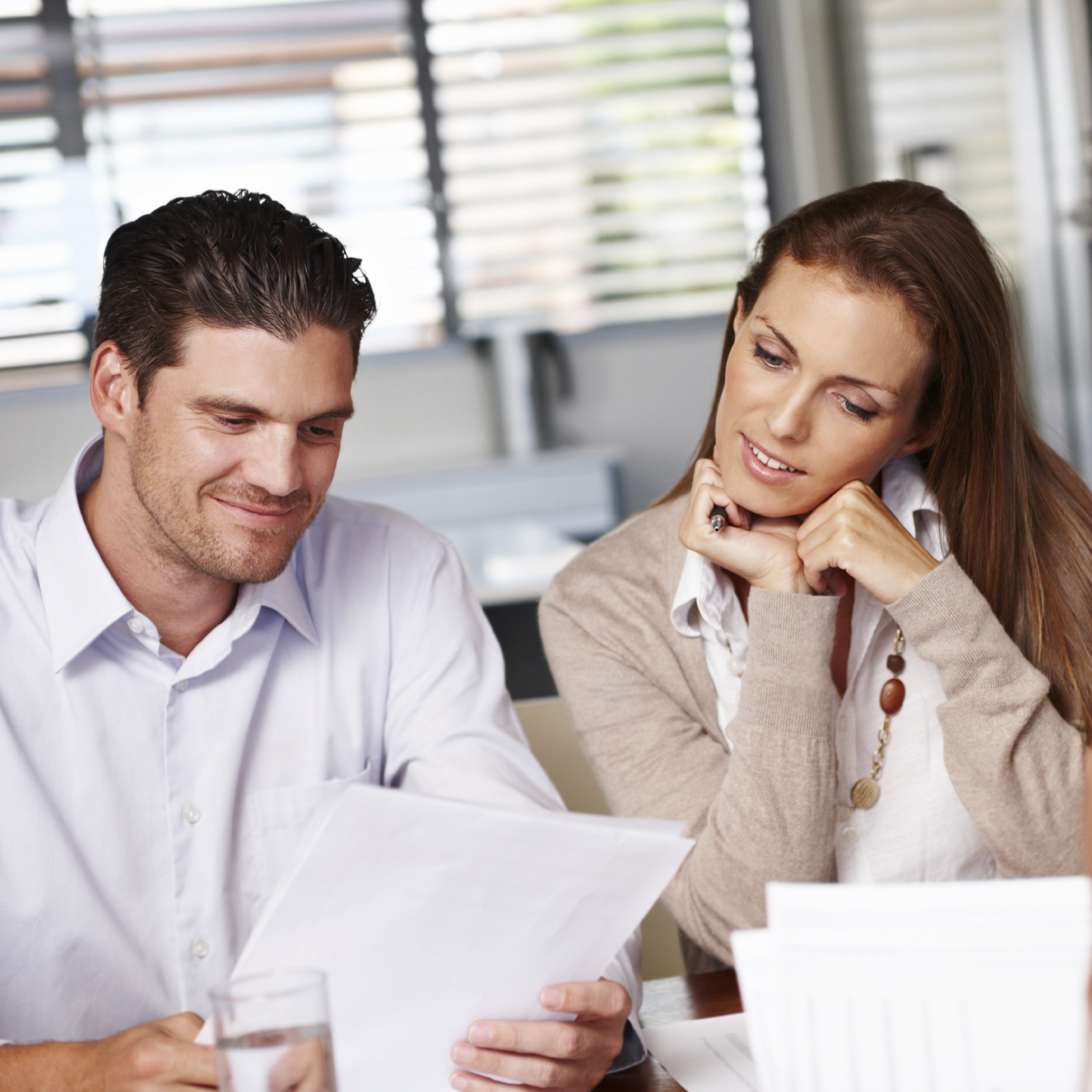A young couple going over some documents with their financial advisor